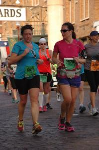 My (former) running partner and I running through the Ft Worth Stockyards.  LOVE Cowtown route!