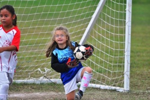 "Alli's one season of soccer.  She would CRY unless she played goalie.  After the game, she would announce that she ""saved all but 5"""